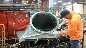 A Journeyman Sheet Metal Worker Fabricating a Square-to-Round from Galvanized Steel.