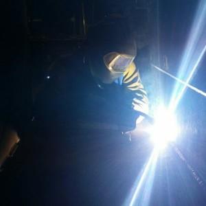 A Journeyman Sheet Metal Worker MIG Welding Steel.