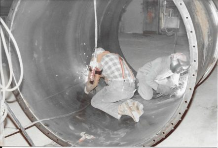 Large, round welded sheet metal duct fabrication.